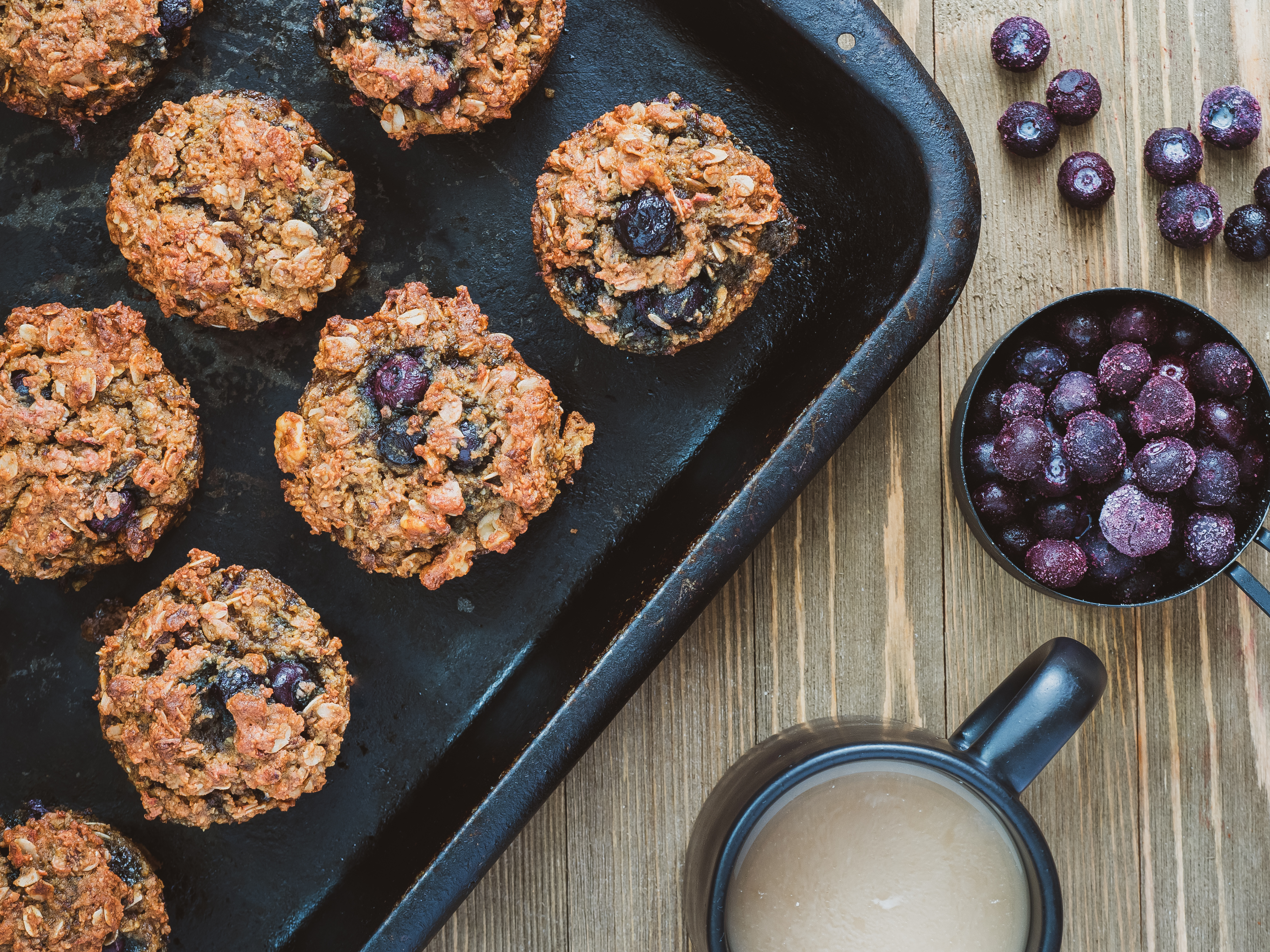Muffins made with grated beet roots and frozen blueberries.